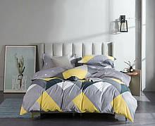 Комплект постельного белья серо-желтый из микросатина двуспальный.