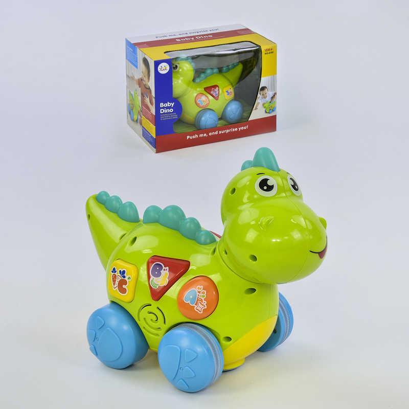 Динозаврик 6105 (18) ездит, говорит на английском языке, проигрывает мелодии и звуки, с подсветкой, в коробке