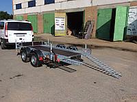 Прицеп для перевозки квадроциклов.