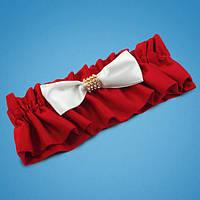 Подвязка на ногу невесты в яркокрасных тонах с белым бантиком