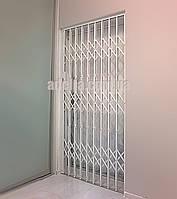 Решетки раздвижные на двери Шир.1130*Выс2100мм для квартиры, фото 1