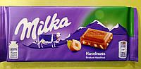 Шоколад Milka з подрібненим фундуком молочний 100 г, фото 1