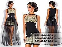 Оригинальное женское платье с гипюровой отделкой  и пышной длинной обкой из фатина на атласном поясе черное