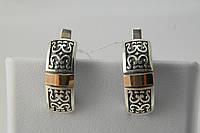 Нарядные серебряные серьги с чернением и золотом