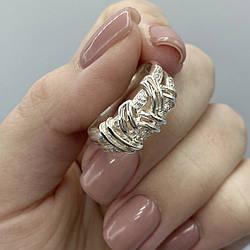 Серебряное кольцо с узором косички и  камнями.