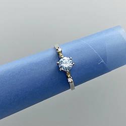 Серебряное кольцо с голубым камнем