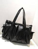 Женская стильная кожаная сумка с накладными карманами.