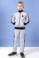 Спортивный костюм для мальчиков Skil 134 светло-серый