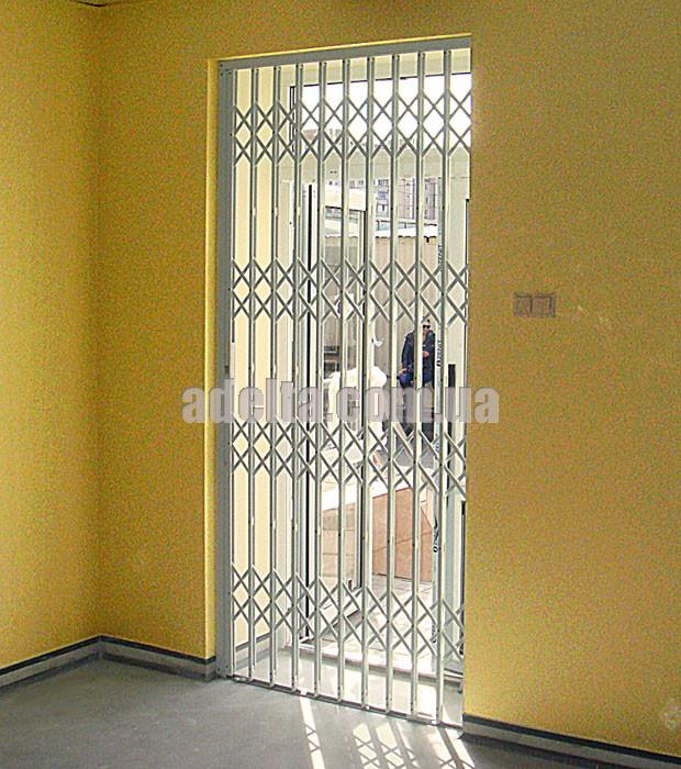 Раздвижная защитная решетка на дверь Шир.1250*Выс3000мм для офисов