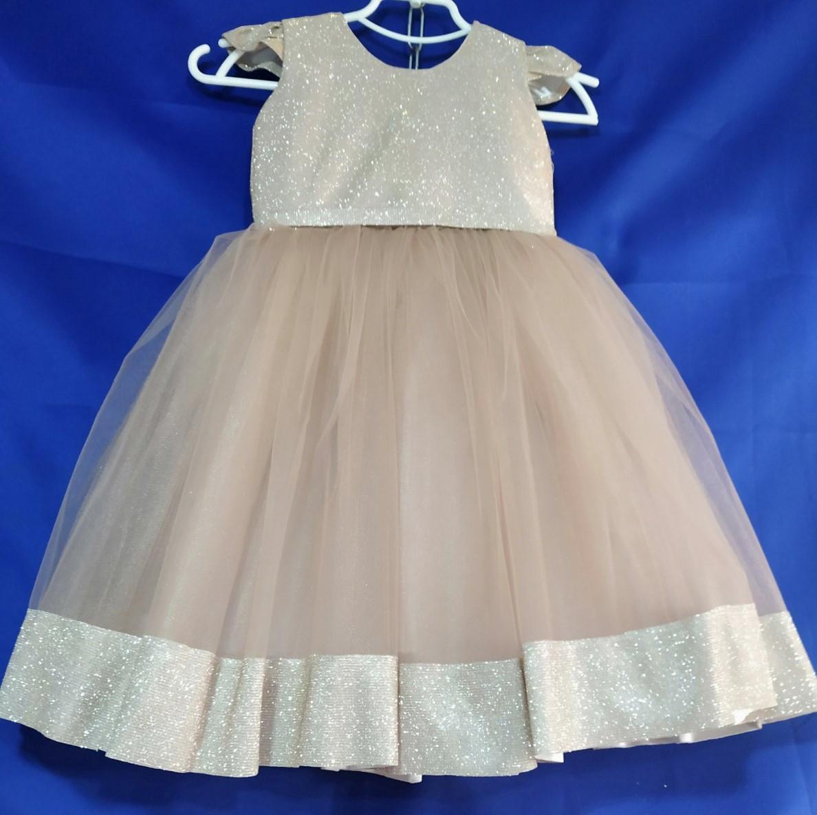 Детское нарядное платье на девочку 4-6 лет бежевого цвета
