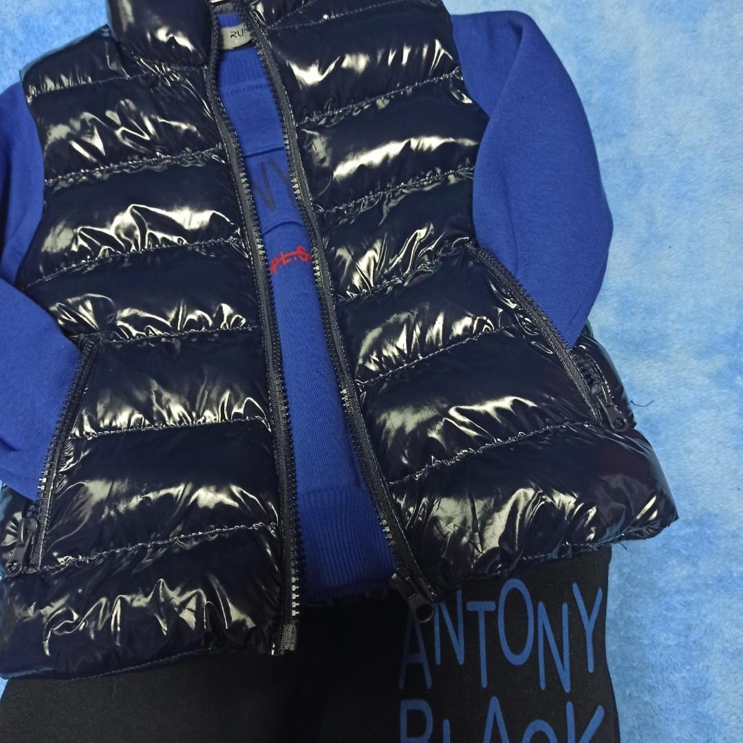 Нарядный модный теплый костюм с жилеткой.В комплект входит кофта. штаны и жилет. Штаны внизу на манжете.