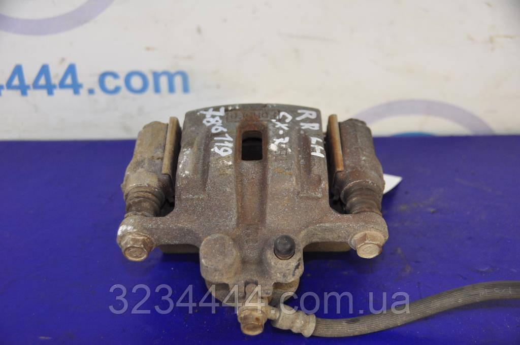 Супорт задній R правий MAZDA CX-7 06-12