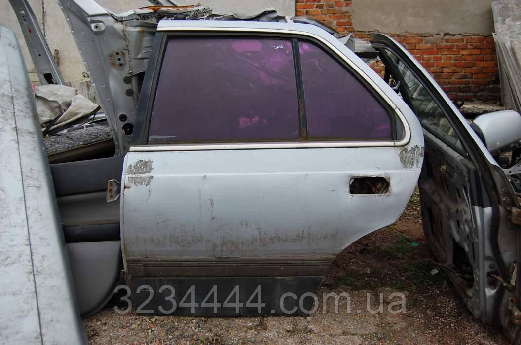 Дверь RL задняя левая MAZDA 929 HC 86-91