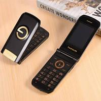 Телефон кнопочный раскладушка с батареей большой емкости и камерой на 2 sim Tkexun G3 black