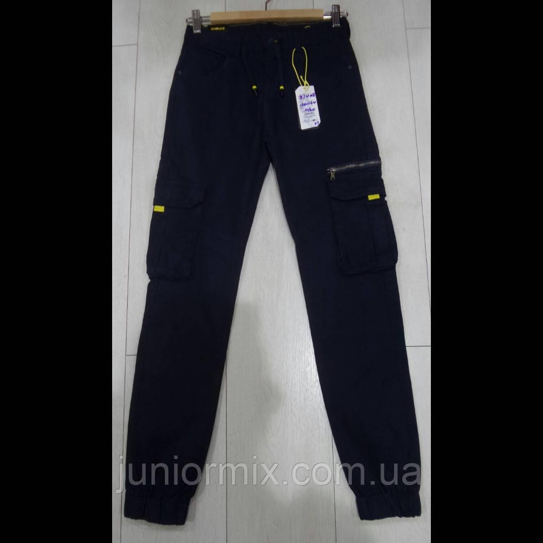 Котоновые  подростковые синие брюки для мальчика синего цвета оптом GRACE