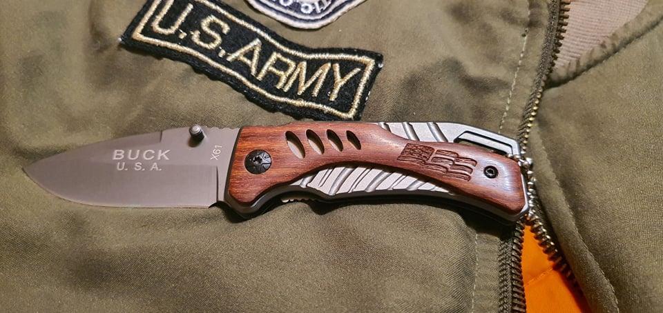 Охотничий нож складной Buck A134 коричневый