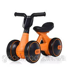 Толокар M 4086-7 мотоцикл, муз., світло, кольорова коробка, помаранчевий.