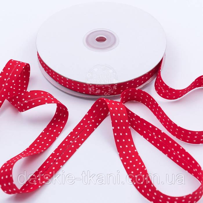Косая бейка из хлопка красного цвета в белые точки, ширина 15 мм.