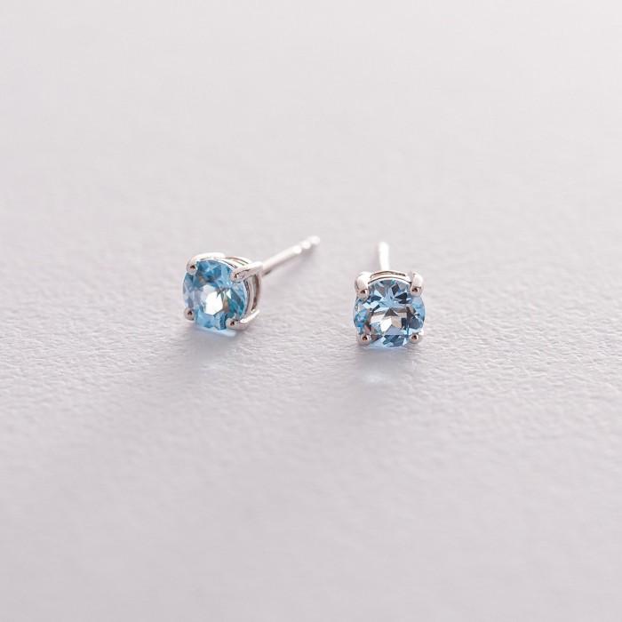 Золотые серьги-пусеты с голубым топазом сб0112gl