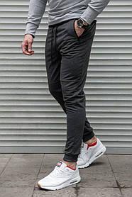 Мужские спортивные штаны серого цвета на манжетах