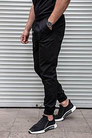 Черные брюки джоггеры из хлопка на манжетах