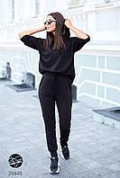 Женский трикотажный костюм черного цвета с капюшоном. Модель 29448. Размеры 42-60, фото 1