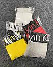 Мужские трусы Calvin Klein желтого цвета с черной резинкой, фото 2