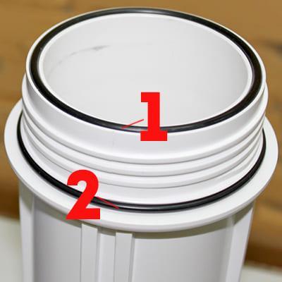 фото колбы и резинок в проточном фильтре