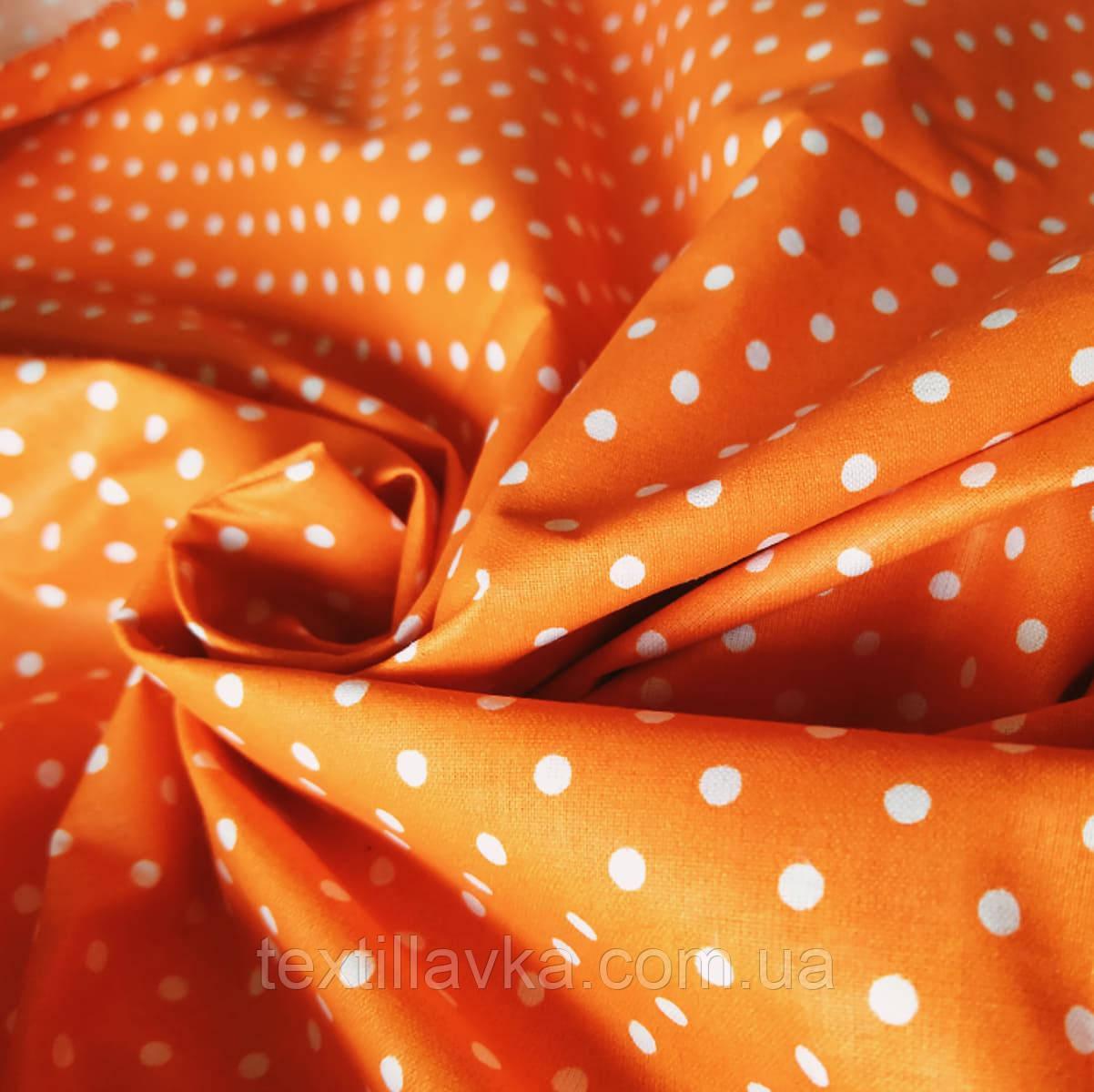 Тканина бавовна коричневі зірочки на пастельно-жовтому фоні