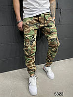 Джинсы джогеры мужские камуфляжные с манжетами коричнево-зеленые модные