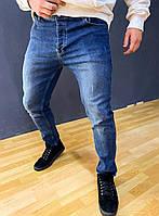 Джинсы мужские зауженные синего цвета с потертостями
