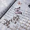 Бязь з метеликами, пір'їнками, написами і гілочками на сірому, ш. 220 см