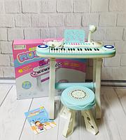 Детский синтезатор - пианино со стульчиком, микрофоном, регулятором громкости