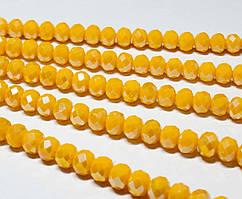 Бусины хрустальные (Рондель) 8х6мм  пачка - примерно 70 шт, цвет - непрозрачный янтарный с АБ