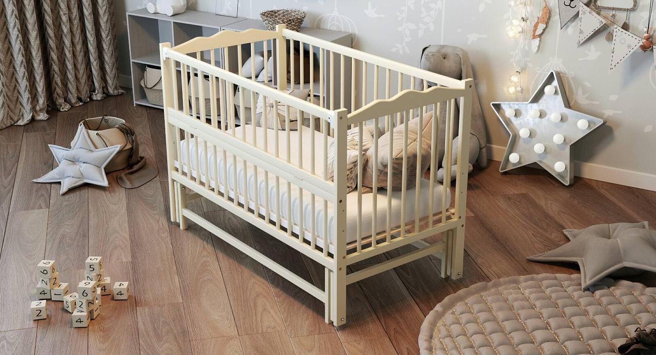 """Дитяче ліжечко Дубик-М """"Веселка"""" слонова кістка, з відкидною боковинкою на маятнику."""