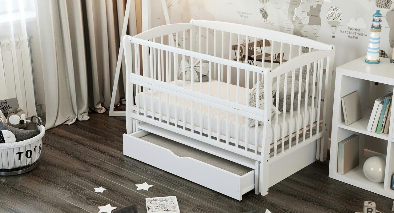 """Дитяче ліжечко Дубик-М """"Еліт """" сніжно біле з відк.боковинкою та шухлядою."""