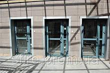 Двері алюмінієві протипожежні з склінням до 90% зовнішні