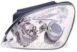Фара левая механич./электро Н7+Н1 для Kia Carens 2007-11