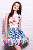 Нежное женское платье с цветочным принтом и расклешенным низом