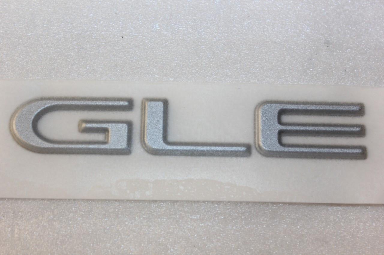 Напис GLЕ Нексія GM Корея (оригінал)