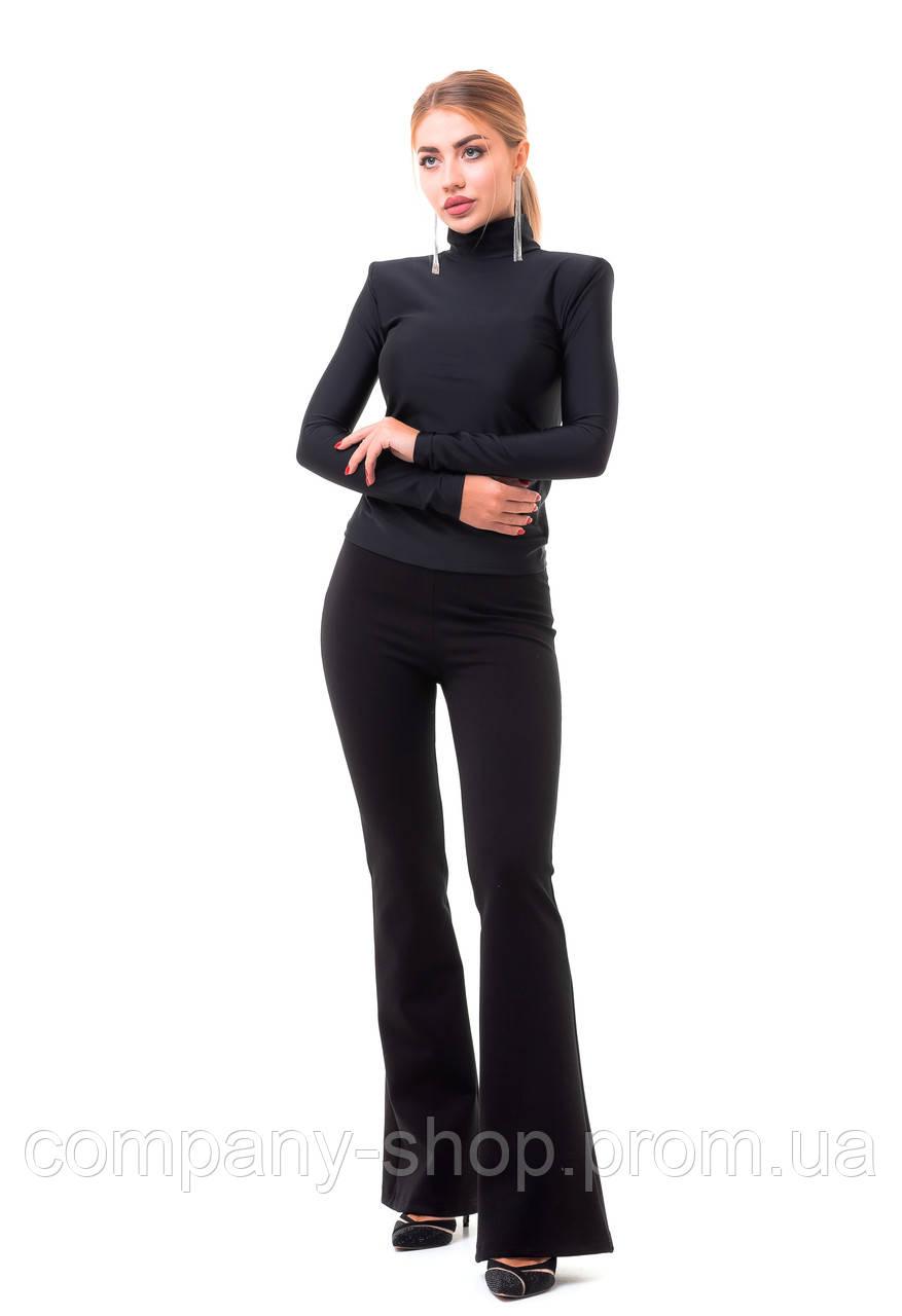 Женские стильные брюки клеш на широком поясе.