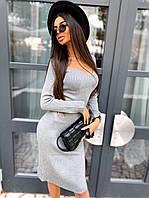 Плаття жіноча міді з глибоким вирізом