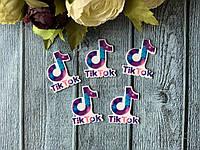 Кабошон «Tik Tok логотип сиренево-голубой» 3,5 х 2,5 см, 20 шт/уп. оптом, фото 1