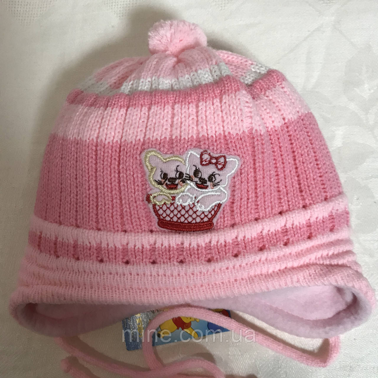 Розовая вязаная  детская шапочка на флисе возраст до года
