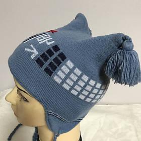 Сіро-блакитна шапочка з пензликами з бубоном з малюнком