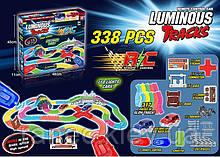 Автотрек игрушечный  D6088  на ру, светящийся, 338 дет, в кор 48*11*43 см