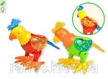 Музыкальная развивающая игрушка животное 2068 Попугай, 2 цвета, свет,звук, движение, в кор 22*17*25см