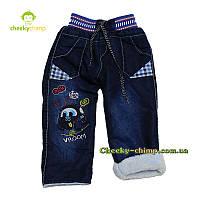 Крутые темно-синие джинсы на мальчика