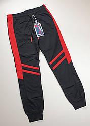 Спортивные штаны на  мальчика 8, 10 лет черный с красными вставками , Венгрия