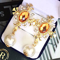 """Шикарные серьги """"Императрица"""" золотистого цвета."""